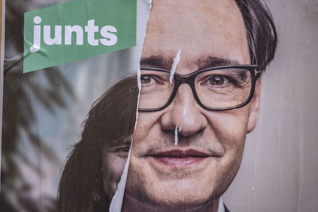 An electoral poster of the independence candidate, Laura Borràs is seen on La Rambla covered by another of the socialist candidate, Salvador Illa
