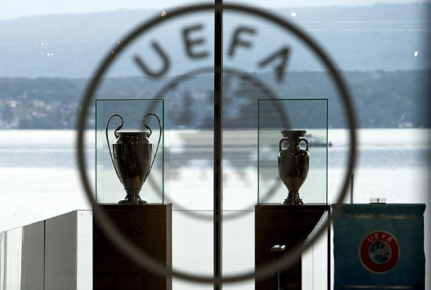 Nyon (Switzerland Schweiz Suisse).- (FILE) - The UEFA Champions League trophy (L) and the Henri Delaunay trophy (R) of the UEFA EURO soccer championship on display at the UEFA headquarters in Nyon, Switzerland, 18 September 2014